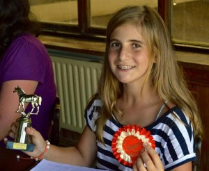 Helena with trophy and red rosette
